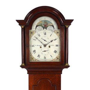 oak moonohase longcase clock by Wrapson of Chichester hood